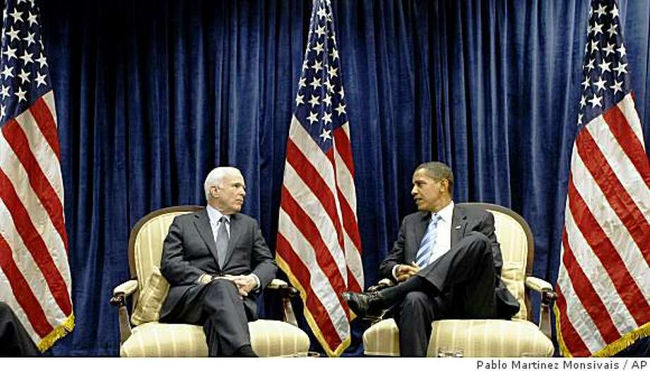 President-elect Barack Obama, right, meets with Sen John McCain, R-Ariz., Monday, Nov. 17, 2008, at Obama's transition office in downtown Chicago. (AP Photo/Pablo Martinez Monsivais) Photo: Pablo Martinez Monsivais, AP