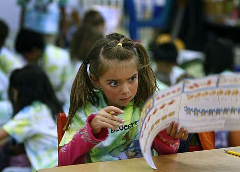 Gabby Griffin studies a worksheet in her kindergarten class at Thornhill Elementary School in Oakland, Calif., on Wednesday, June 9, 2010. If approved, a bill would restrict minimum age of enrollment in kindergarten classes to five-years-old. Photo: Paul Chinn, The Chronicle