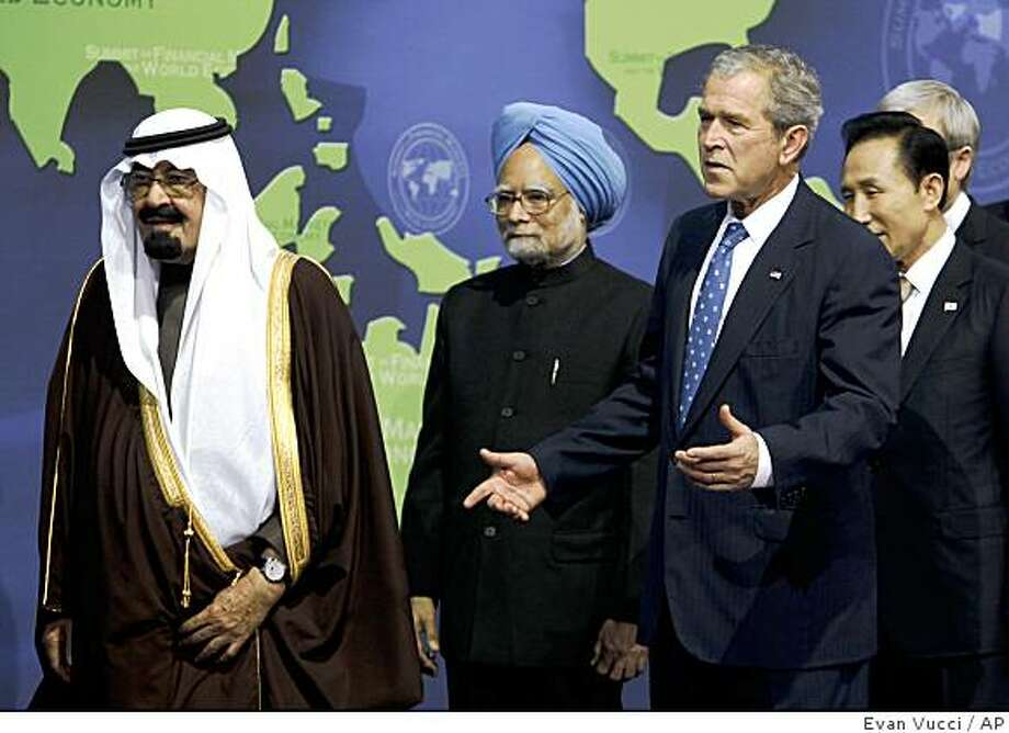 President George W. Bush, third from left, reacts after Argentina President Cristina Fernandez de Kirchner missed the first group photo Saturday, Nov. 15, 2008, in Washington.  President Bush invited leaders of the G-20 community to Washington for a weekend summit to discuss the world economy and the current condition of the financial markets.  From left, Saudi Arabia King Abdullah, India Prime Minister Manmohan Singh, Bush, and South Korea President Lee Myung-bak.  (AP Photo/Evan Vucci) Photo: Evan Vucci, AP