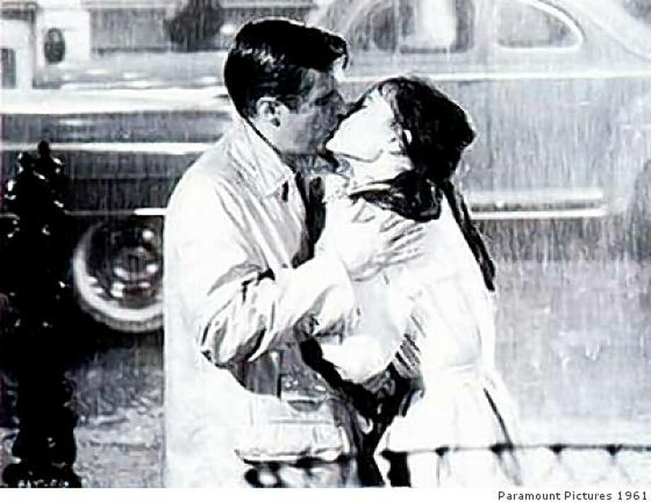 "George Peppard and Audrey Hepburn in the last scene of ""Breakfast at Tiffany's."" Photo: Paramount Pictures 1961"