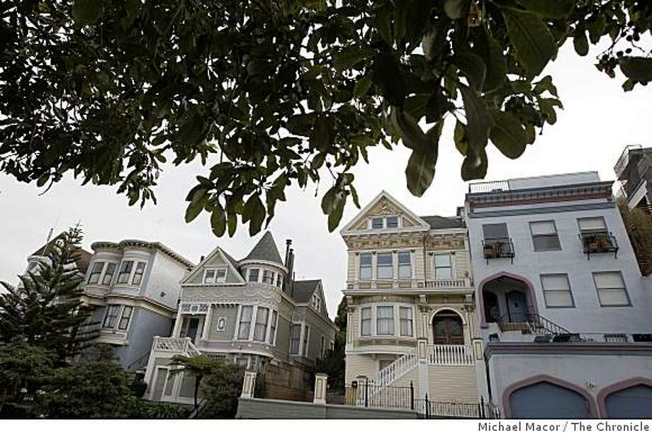 A row of homes along Fulton Street between Steiner and Fillmore Steets,  on the edge of Alamo Square San Francisco, Calif., on Tuesday Nov. 11, 2008. Photo: Michael Macor, The Chronicle