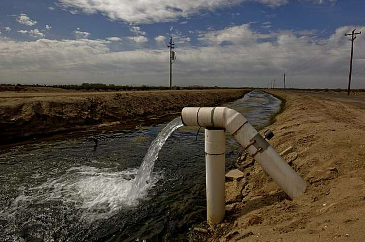 The Columbia irrigation canal runs along Eastside Road East of Mendota, Calif. on Tuesday September 29, 2009. As part of a landmark federal settlement, water will be released from the Friant Dam on Oct. 1, 2009, beginning the restoration of the San Joaquin River.