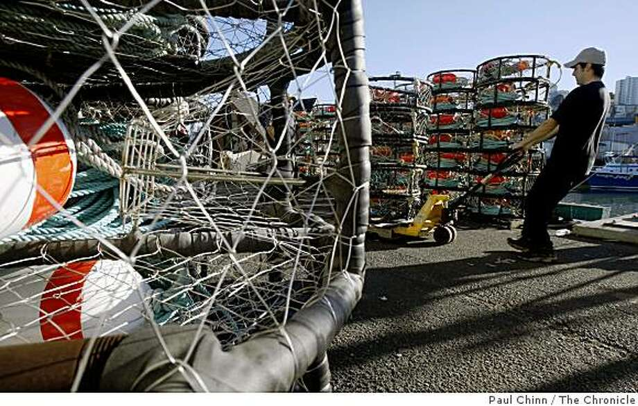 Joel Brady-Power moves crab pots to the fishing boat Kelly-L at Pier 45 on the first day of crab fishing season in San Francisco, Calif., on Friday, Nov. 14, 2008. Photo: Paul Chinn, The Chronicle