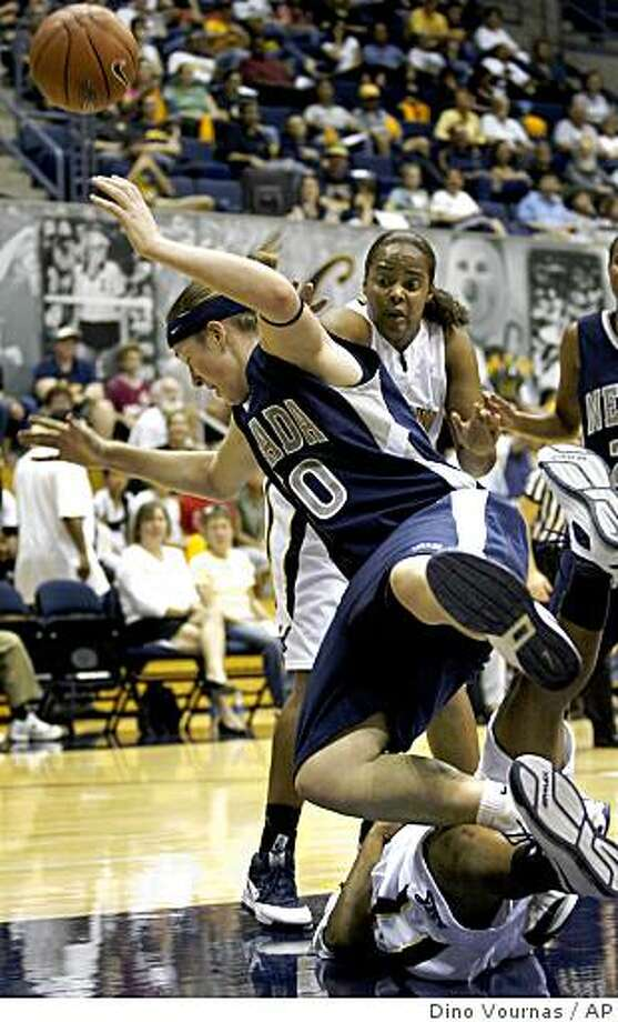 Nevada's Marissa Hammond, foreground, falls over an unidentified  California player while being guarded by Shantrell Snead, back, in the first half of an NCAA basketball game, Sunday, Nov. 16, 2008, in Berkeley, Calif.  (AP Photo/Dino Vournas) Photo: Dino Vournas, AP