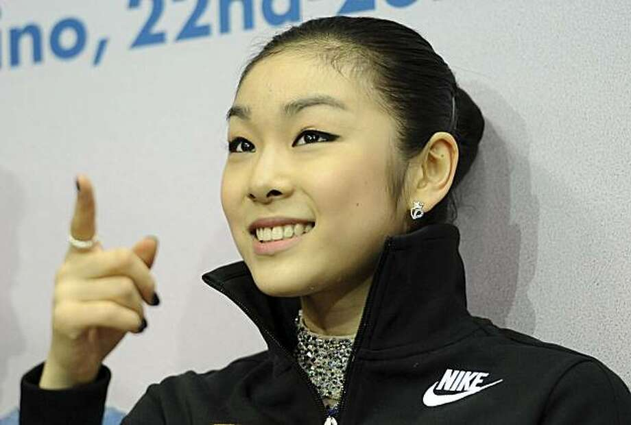 FILE - This March 27, 2010, file photo showsSouth Korea's Kim Yu-Na reacting after performing in the free skating competition, at the World Figure Skating Championships in Turin, Italy. A lawyer for Olympic champion Kim Yu-na says the South Korean figureskater is splitting with her agent and setting up her own management company. Photo: Massimo Pinca, AP