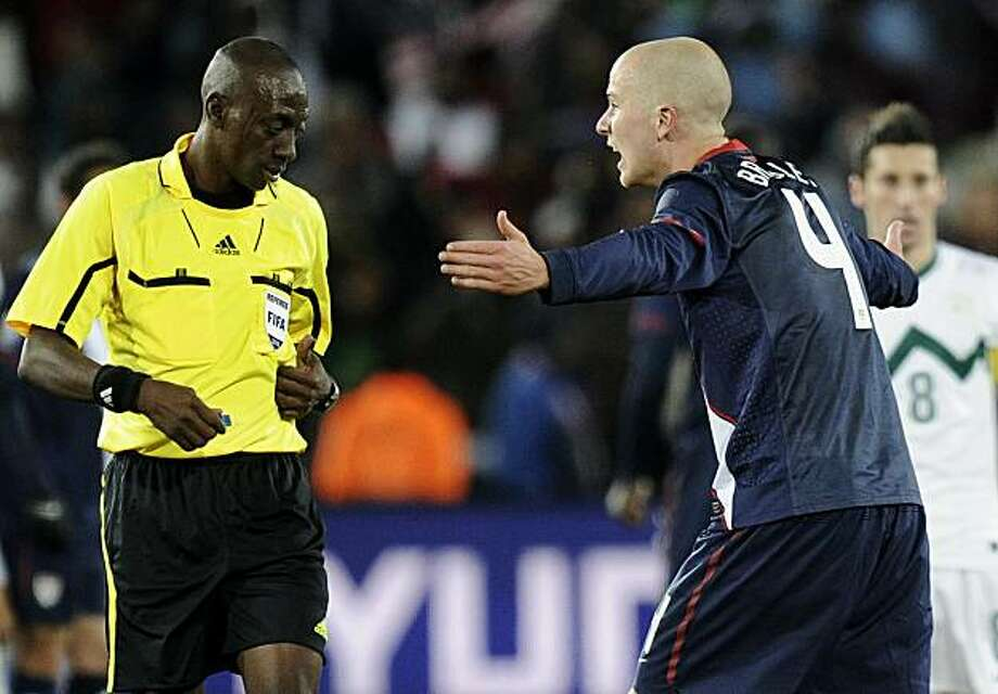 United States' Michael Bradley, right, remonstrates with referee Koman Coulibaly of Mali, left, during the World Cup group C soccer match between Slovenia and the United States at Ellis Park Stadium in Johannesburg, South Africa, Friday, June 18, 2010. Photo: Martin Meissner, AP