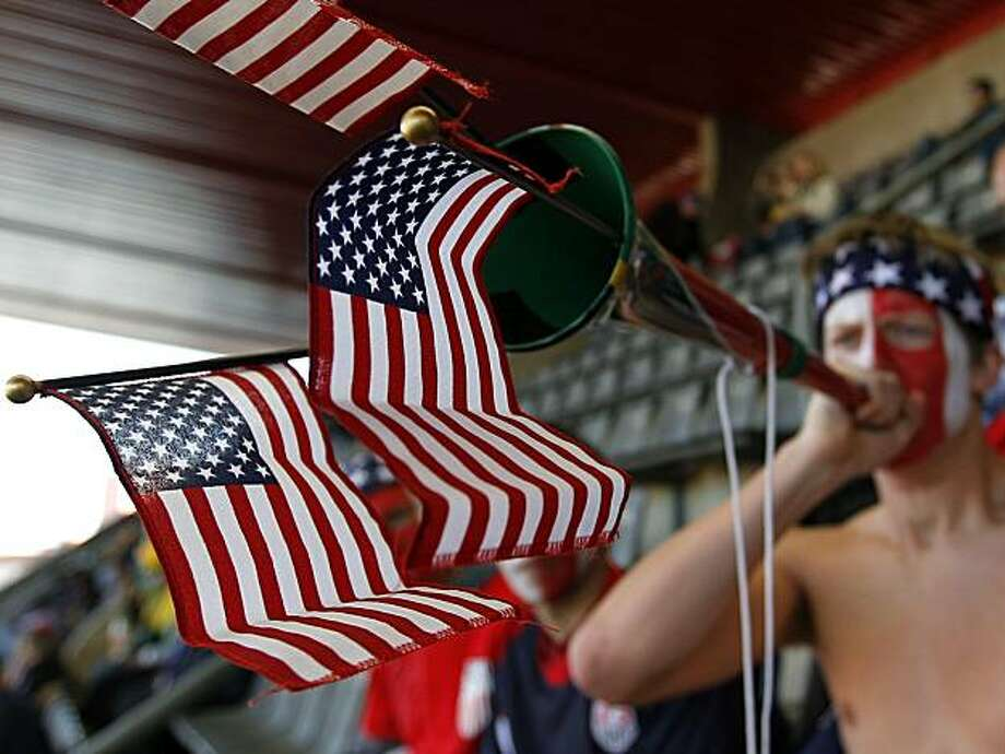 A United States' fan blows a vuvuzela prior to the World Cup group C soccer match between Slovenia and the United States at Ellis Park Stadium in Johannesburg, South Africa, Friday, June 18, 2010. Photo: Hassan Ammar, AP