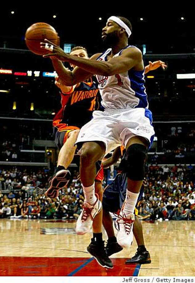 LOS ANGELES, CA - NOVEMBER 15:  Baron Davis #1 of the Los Angeles Clippers looks to pass the ball while being defended by Andris Biedrins #15 of the Golden State Warriors during the second half at Staples Center on November 15, 2008 in Los Angeles, California. The Warriors defeated the Clippers 121-103. NOTE TO USER: User expressly acknowledges and agrees that, by downloading and/or using this Photograph, user is consenting to the terms and conditions of the Getty Images License Agreement.  (Photo by Jeff Gross/Getty Images) Photo: Jeff Gross, Getty Images