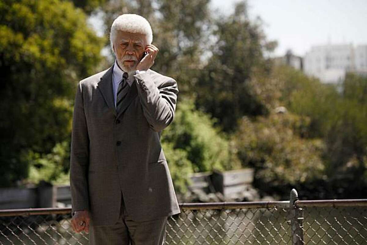 After a press conference to announce an additional $3.45 million in stimulus funds, Oakland Mayor Ron Dellums takes a call on his cell phone near the Lake Merritt wildlife sanctuary on Thursday April 22, 2010 in Oakland Calif.