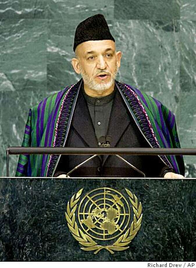 Hamid Karzai, president of Afghanistan, addresses the Culture of Peace meeting of the United Nations General Assembly at UN headquarters, Wednesday Nov. 12, 2008. (AP Photo/Richard Drew) Photo: Richard Drew, AP