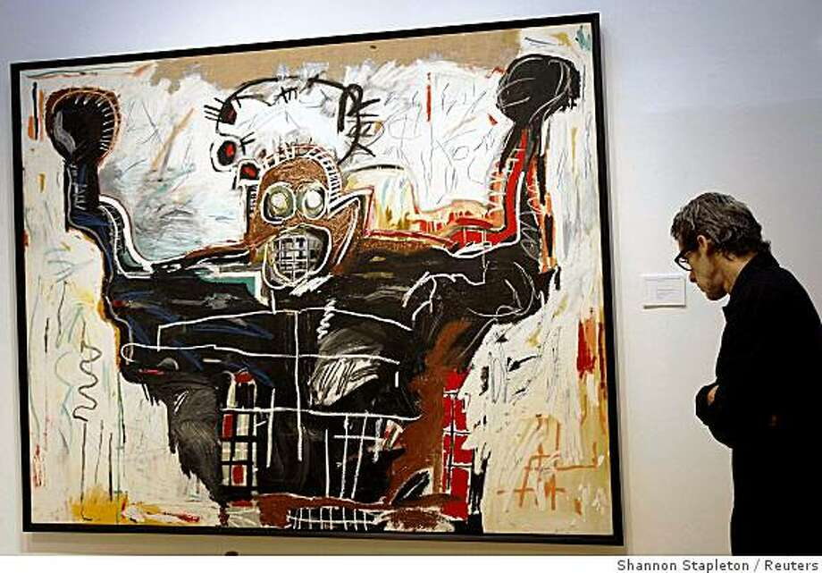 A man views Basquiat's Unititled (Boxer) at Christie's in New York October 30, 2008.  The piece is part of Christie's Post-War & Contemporary Art evening sale that will take place on November 12.    REUTERS/Shannon Stapleton (UNITED STATES) Photo: Shannon Stapleton, Reuters