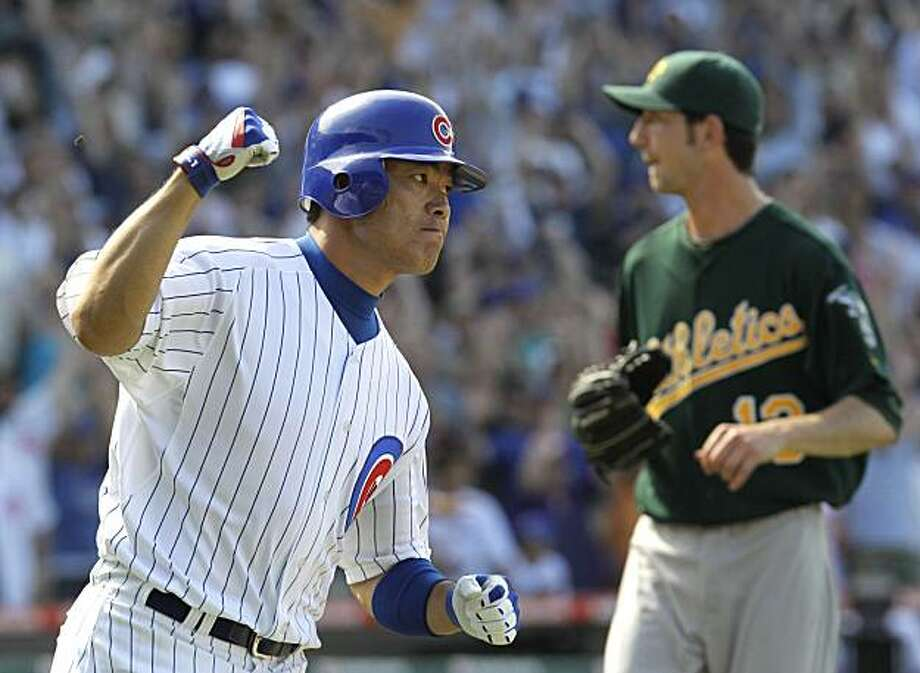 Chicago Cubs' Kosuke Fukudome, left, pumps his fist after driving in the game-winning run with an RBI single off Oakland Athletics relief pitcher Jerry Blevins, right, during the ninth inning of an interleague baseball game, Thursday, June 17, 2010, at Wrigley Field in Chicago. The Cubs won 3-2. Photo: Charles Rex Arbogast, AP