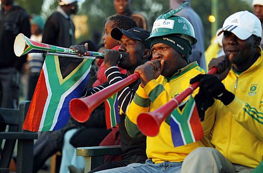 Fans of South Africa's national soccer team bafana bafana blow vuvuzelas as they wait at a fan park for the start of their team's soccer World Cup Group A game against Uruguay in Johannesburg, South Africa, Wednesday, June 16, 2010. Photo: Ricardo Mazalan, AP