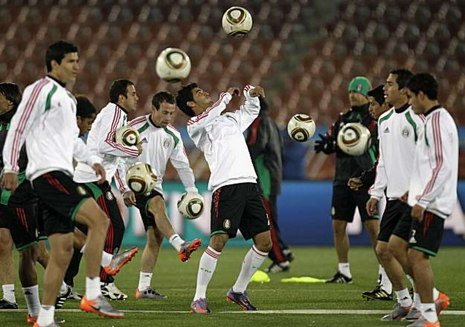 Mexico's national team player Carlo Vela, center, warms-up with teammates during a training session at the Peter Mokaba stadium in Polokwane,  Wednesday, June 16, 2010, prior to their  Group A soccer World Cup match against France on June 17. Photo: Guillermo Arias, AP