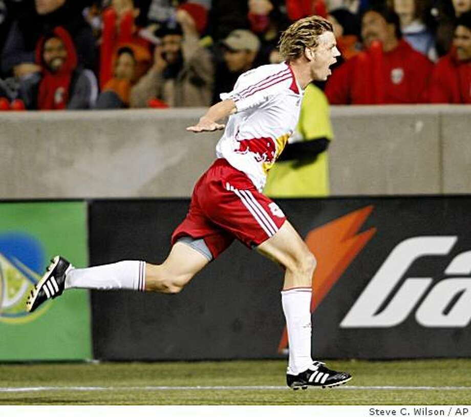 New York Red Bulls midfielder Dave van den Bergh (11), of the Netherlands, celebrates his goal against Real Salt Lake during the first half of the MLS Western Conference Final soccer game Saturday, Nov. 15, 2008, in Sandy, Utah. (AP Photo/Steve C. Wilson) Photo: Steve C. Wilson, AP