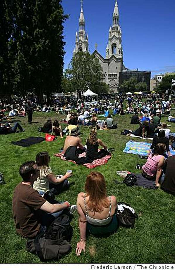 Hundreds relax on the grass at Washington Square at the North Beach annual street festival in San Francisco on Saturday. Photo: Frederic Larson, The Chronicle