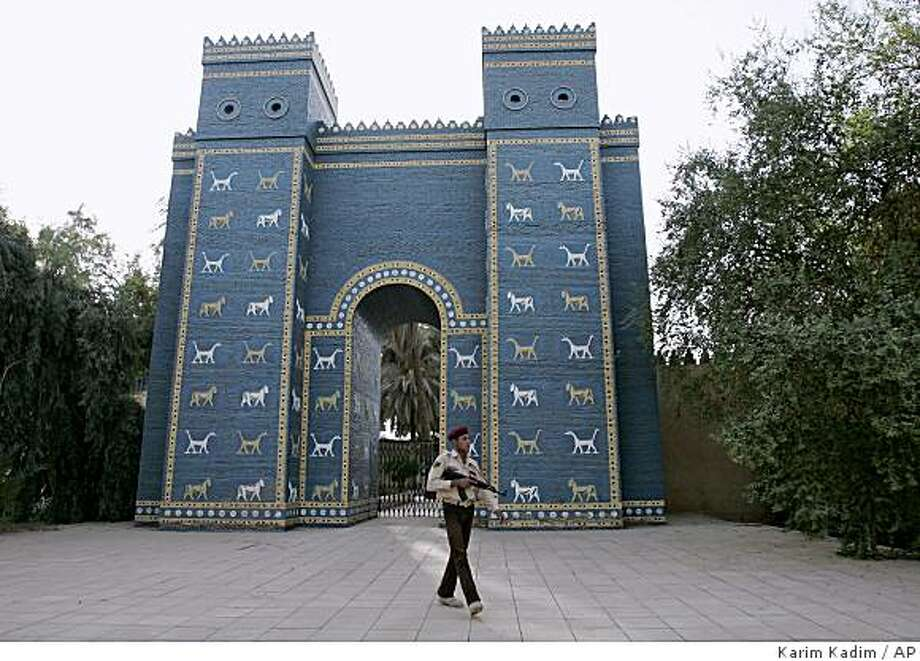 ** ADVANCE FOR WEDNESDAY, NOV. 12 ** An Iraqi armed soldier walks in front of Ishtar Gate of ancient Babylon about 80 kilometers, 50 miles, miles south of Baghdad, Iraq, Sept. 18, 2008. Babylon was once among the greatest cities in the world, home of the Hanging Gardens and the place where Alexander the Great died. (AP Photo/Karim Kadim) Photo: Karim Kadim, AP