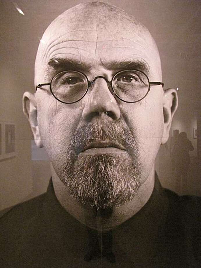 This detail photo of a Chuck Close photograph at Pier 24 photography shows how glare from the frame's glass can cause a reflection. Photo: Matt Petty