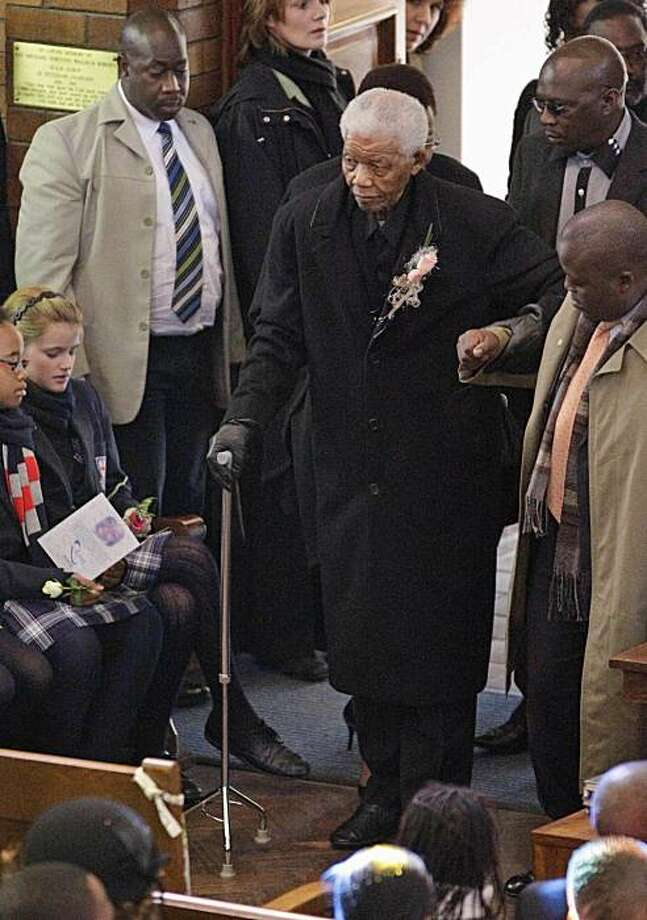 Former South African Former President Nelson Mandela arrives to attend the memorial of his great-granddaughter Zenani Mandela at the St Stithian's College Chapel in Sandton, north of Johannesburg, South Africa, Friday, June 17, 2010. Thirteen-year-old Zenani Mandela was killed in a car that overturned on June 10 as it took her home from a pre-World Cup concert in Soweto. Photo: Themba Hadebe, AP