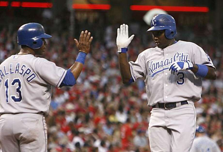 Kansas City Royals' Yuniesky Betancourt, right, is congratulated by teammate Alberto Callaspo, left, after hitting a two-run home run off Cincinnati Reds pitcher Bronson Arroyo in the sixth inning of a baseball game Friday, June 11, 2010, in Cincinnati. The Royals won 6-5 in 11 innings. Photo: David Kohl, AP
