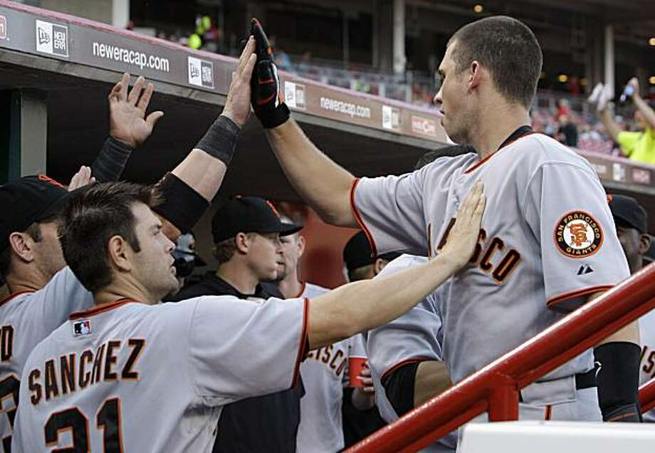 San Francisco Giants' Buster Posey, right, is congratulated by Freddy Sanchez (21) and Aaron Rowand after Posey hit a two-run home run off Cincinnati Reds starting pitcher Aaron Harang in the second inning of a baseball game Wednesday, June 9, 2010, in Cincinnati. Photo: Al Behrman, AP