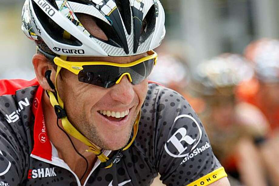US Lance Armstrong from team Radioshack, smiles, during the 2nd stage, a 167,5 km race from Ascona to Sierre, at the 74nd Tour de Suisse UCI ProTour cycling race, near Ascona, Switzerland, Sunday, June 13, 2010. AP Photo/Keystone/Jean-Christophe Bott) Photo: Jean-Christophe Bott, AP