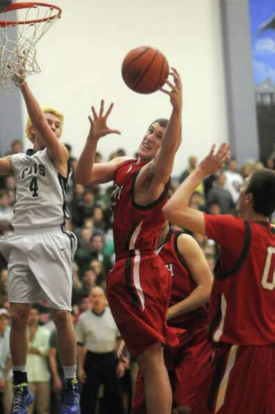 Andrew Butchello of The Woodlands goes for a rebound after Zach Wright (4) of College Park attempted