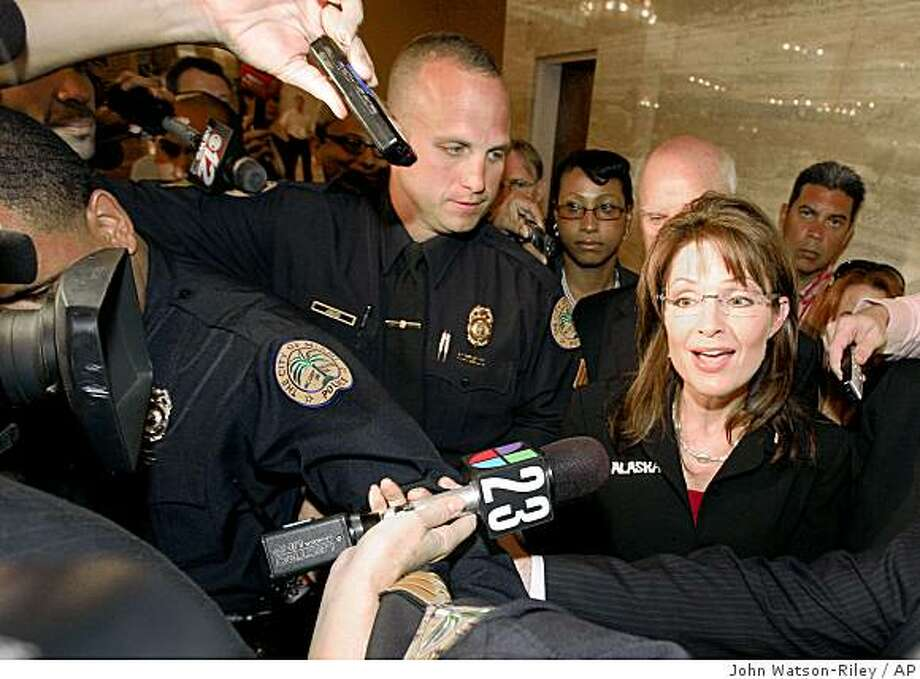 Alaska Gov. Sarah Palin speaks to reporters as she arrives at the 2008 Republican Governors Association meeting in Miami, Fla., Wednesday, Nov. 12, 2008. Palin said Wednesday that a woman would be good for the Republican presidential ticket in four years. (AP Photo/John Watson-Riley) Photo: John Watson-Riley, AP