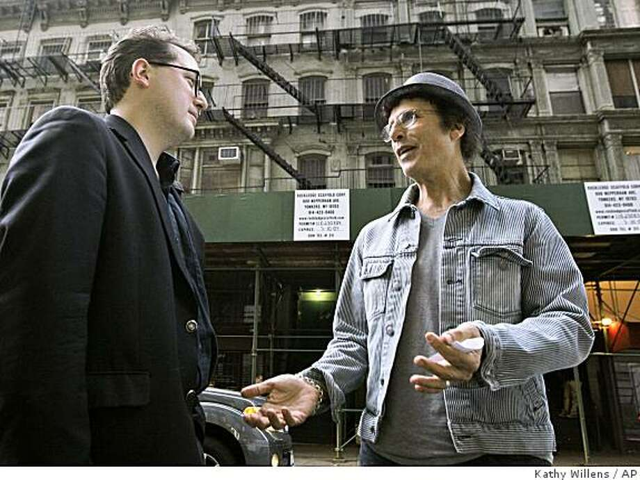 Simeon Banoff, left, an advocate for New York City's historic neighborhoods, and Tin Pan Alley tenant Leland Bobbe stand outside a group of Chelsea buildings that they hope won't be destroyed to be replaced by high rises in New York, Thursday, Oct. 16, 2008. The group of five buildings, including one where Bobbe lives, once housed Irving Berlin, George and Ira Gershwin, and dozens of other great American songwriters. (AP Photo/Kathy Willens) Photo: Kathy Willens, AP