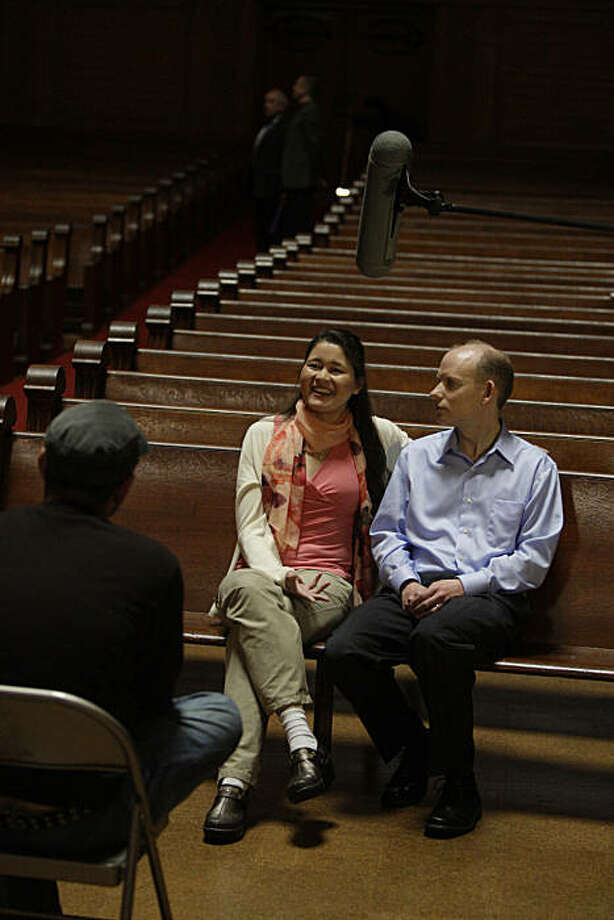 Isabel Stenzel (center) and her husband Andrew Byrnes (right) sit in Stanford Memorial Church while producer/director Marc Smolowitz (left) asks them questions during filming for a documentary at Stanford University in Stanford, Calif. on Tuesday April 27, 2010. Twin sisters, Isabel and Anabel Stenzel  were born with cystic fibrosis and both had lung transplants at Stanford Hospital. They published their memoirs in a book which is now being made into a documentary film. Photo: Lea Suzuki, The Chronicle
