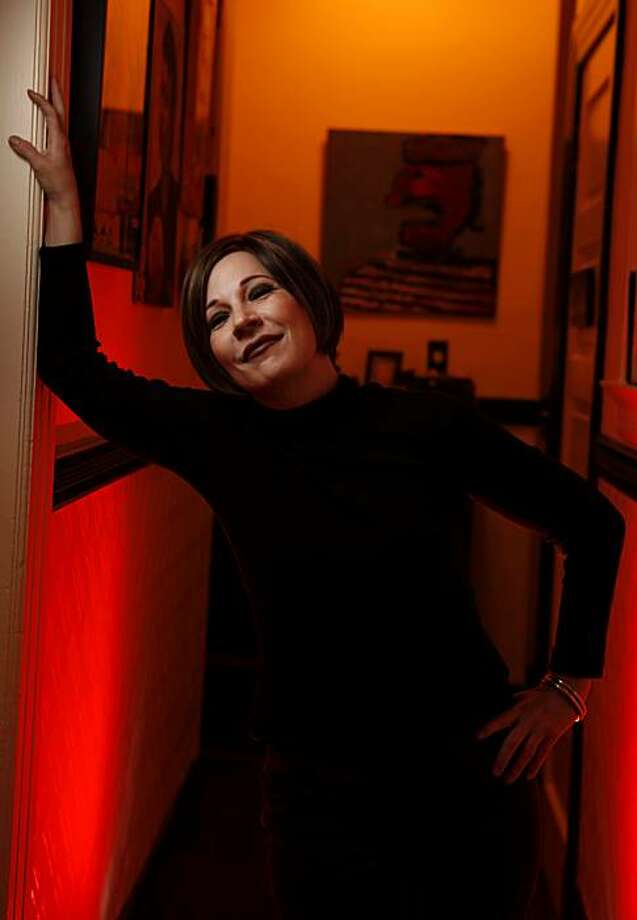 Singer Connie Champagne stands in the hall at her home, Wednesday June 9, 2010, in San Francisco, Calif. She has been performing for more than twenty years and is now doing a nightclub act as Judy Garland. Photo: Lacy Atkins, The Chronicle