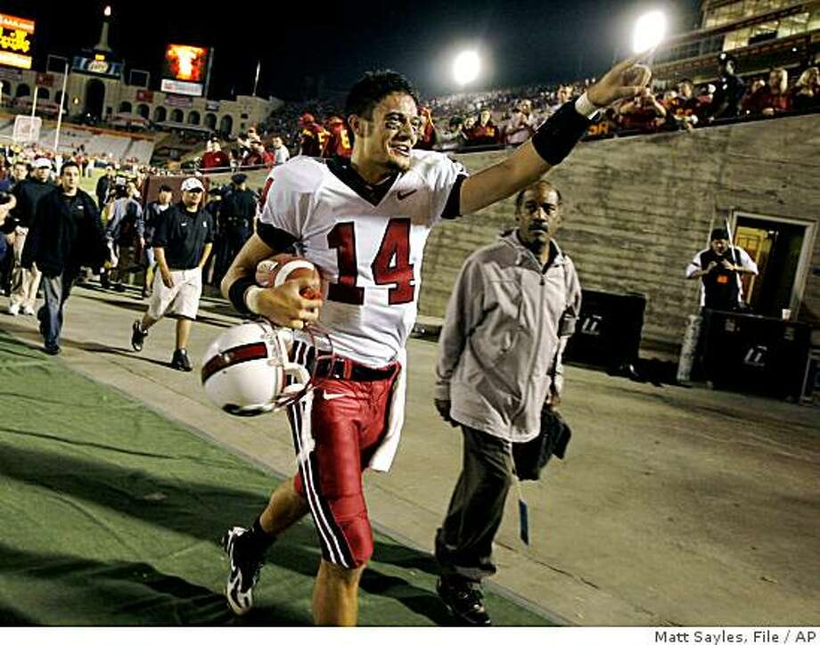 ** FILE ** In this Oct. 6, 2007 file photo, Stanford quarterback Tavita Pritchard celebrates after Stanford's 24-23 upset of Southern California in an NCAA college football game in Los Angeles.  Nobody around Southern California has forgotten the Stanford debacle of last year, when the 41-point underdog Cardinal handed the Trojans their only loss at Los Angeles Coliseum in the past 43 games. No. 6 USC, a 23-point favorite, gets a shot at revenge this weekend in Palo Alto. (AP Photo/Matt Sayles, File) Photo: Matt Sayles, File, AP