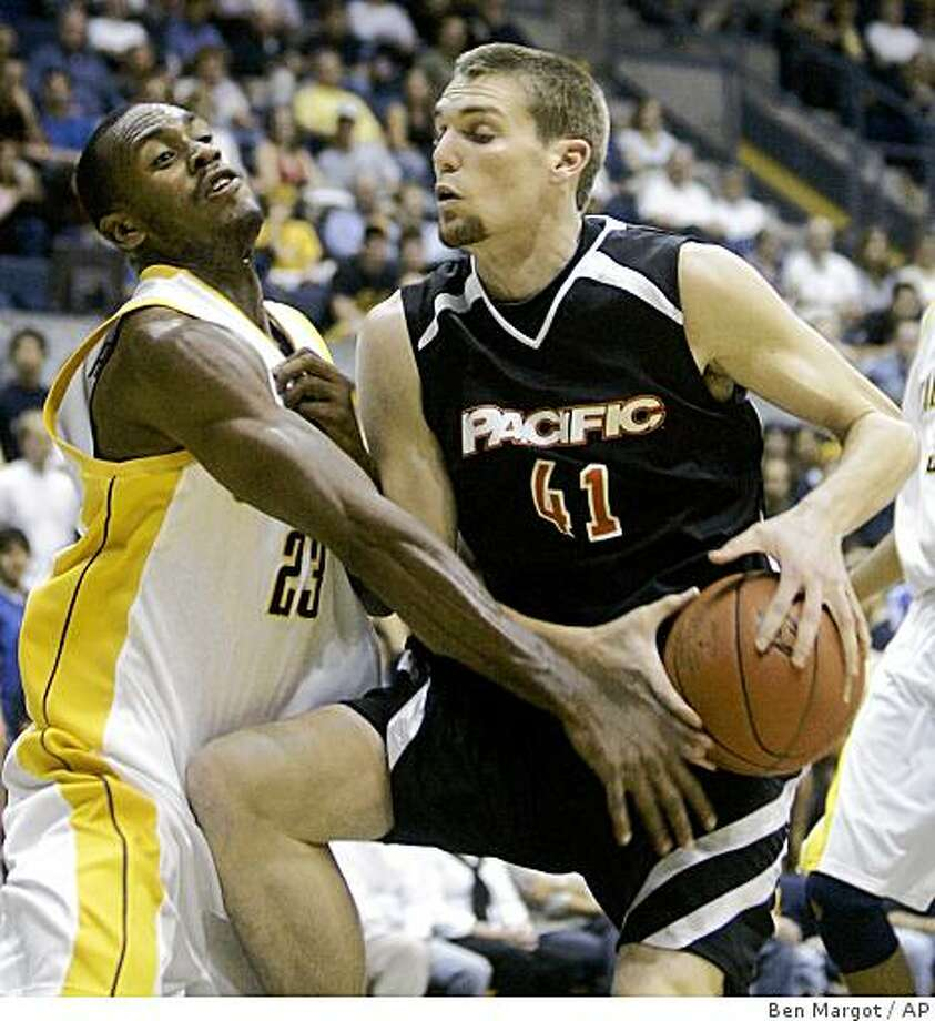 California's Patrick Christopher (23) tries to strip the ball from Pacific's Bryan LeDuc (41) during the first half of a college basketball game Saturday, Nov. 15, 2008, in Berkeley, Calif. (AP Photo/Ben Margot) Photo: Ben Margot, AP