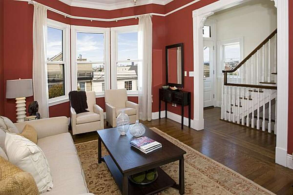 Bay windows look out onto the street from the living room. The Glen Park home spans 2,900 square feet and is priced at $1.699 million.