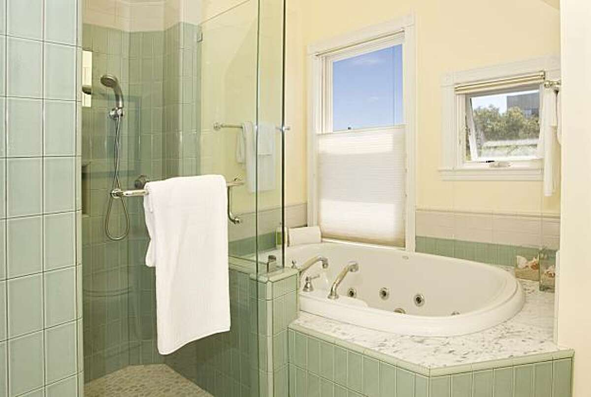 The master bathroom with oversized soaking tub. 181 Randall Street was originally built in 1910 but was rebuilt in 2002. The property includes three modern bathrooms.