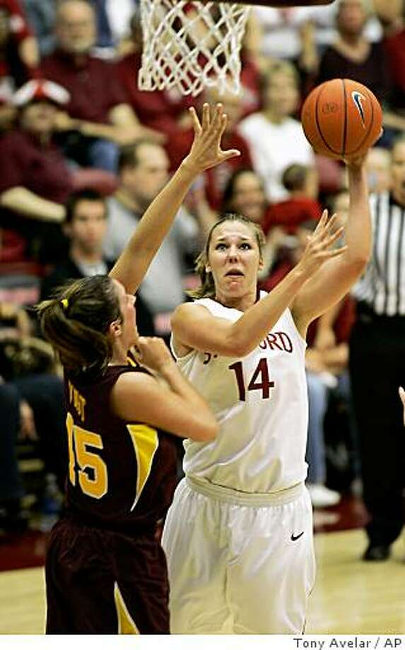 Stanford's Kayla Pedersen, right, takes a shot over Minnesota's Jackie Voigt, left, in the first half of an NCAA women's basketball game Friday, Nov. 14, 2008, in Stanford, Calif. (AP Photo/Tony Avelar) Photo: Tony Avelar, AP