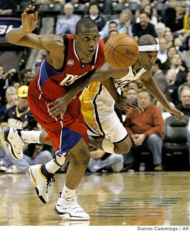 Philadelphia 76ers Forward Thaddeus Young Left And Indiana Pacers Guard T J Ford Battle For