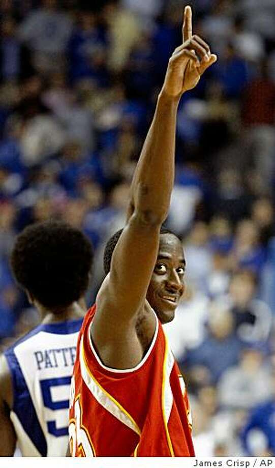 VMI's Travis Holmes celebrates as Kentucky's Patrick Patterson walks away at the end of VMI's 111-103 NCAA college basketball victory at Rupp Arena in Lexington, Ky., on Friday, Nov. 14, 2008. Holmes led his team with 30 points. VMI won 111-103. (AP Photo/ James Crisp) Photo: James Crisp, AP