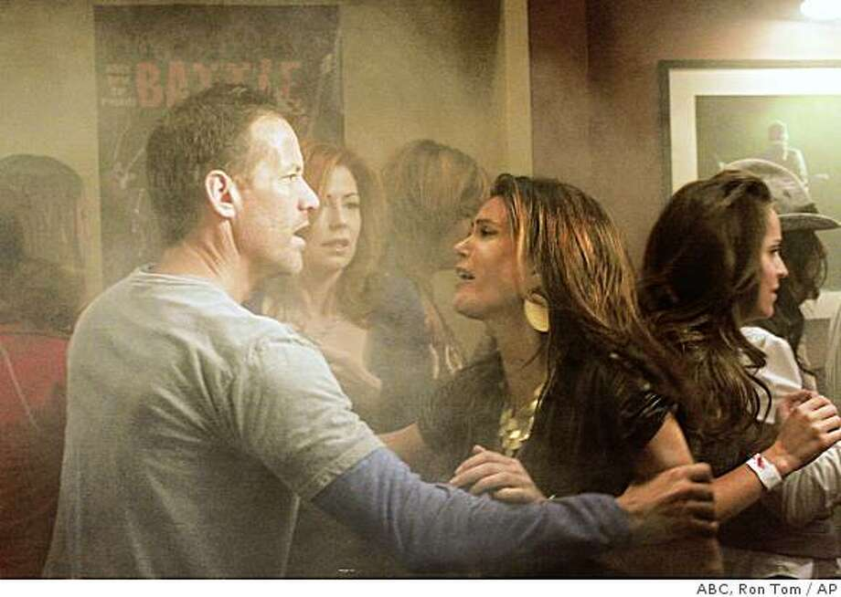 "In this image released by ABC, James Denton, left, Dana Delaney, center, and Teri Hatcher are shown in a scene from, ""Desperate Housewives,"" airing Sunday, Nov. 16, 2008, at 9:00p.m. EDT on ABC. (AP Photo/ABC, Ron Tom) ** NO SALES ** Photo: ABC, Ron Tom, AP"