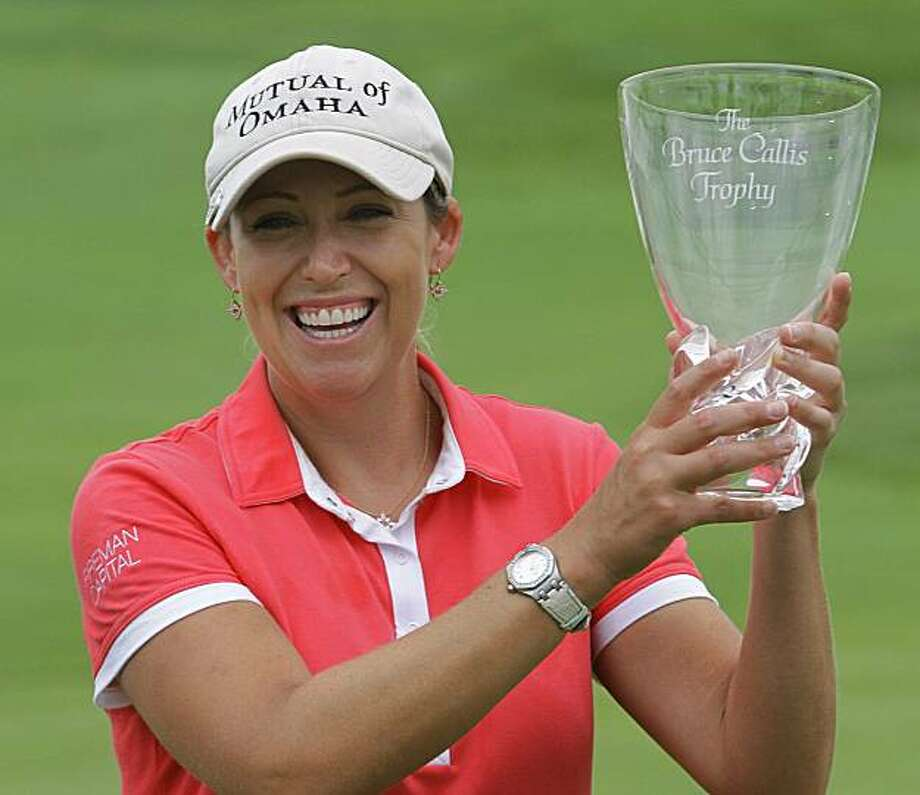Cristie Kerr celebrates with the Bruce Callis trophy after winning the final round  of the LPGA State Farm Classic golf tournament in Springfield, Ill., Monday, June 14, 2010. Photo: Seth Perlman, AP