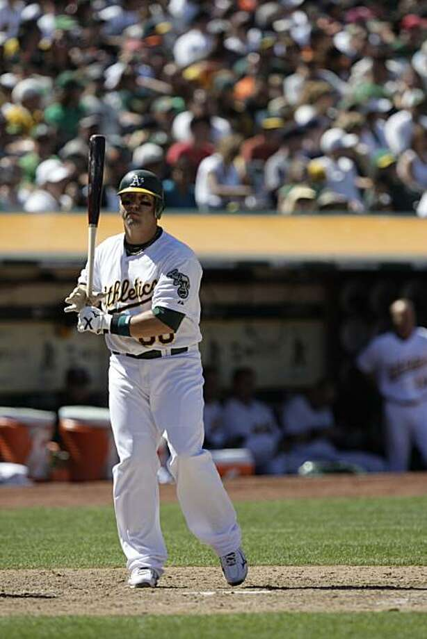 Jake Fox of the Oakland Athletics prepares to bat during the Oakland Athletics vs. San Francisco Giants game at McAfee  Coliseum in San Francisco, Calif. on Sunday May 23, 2010. Final Score: Athletics: 3 vs. Giants: 0. Photo: Lea Suzuki, The Chronicle