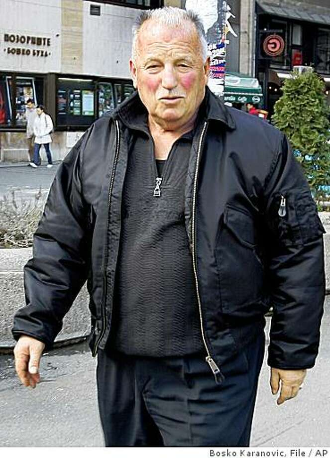 ** FILE  * This is a March 9 2008 file  photo.  of Nikola Kavaja a self-styled assassin to former Yugoslavia's dictator Josip Broz Tito, who claimed Osama Bin Laden had copied his idea of crushing passenger jets into high-rises during the 9/11 attacks, has died of a heart attack, Belgrade media reported Tuesday, Nov. 11, 2008.  In 1979, he hijacked an American Airlines jet in New York and commandeered it over the Atlantic with the intention of crashing it into the high-rise Yugoslav Communist Party headquarters in Belgrade. He was extradited to the U.S. from Ireland where the Boeing 707 landed when he abandoned his highjack mission, saying at the time he was not sure of the exact location of the downtown party headquarters and did not want innocent civilians to die if the jet missed the target. Kavaja, who spent 18 years in a U.S. federal prison on highjack charges, and was released 1999 had claimed that he was recruited by CIA to kill former communist dictator Josip Broz Tito, who ruled Yugoslavia from 1945 until he died in 1980, during his visits to Brazil and Chile in the early 1960s. (AP Photo/Bosko Karanovic, files) Photo: Bosko Karanovic, File, AP