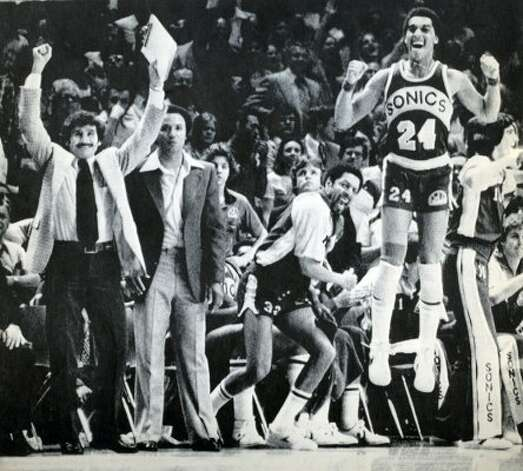 From left, SuperSonics assistant coach Les Habegger, head coach Lenny Wilkens, team captain Fred Brown and guard Dennis Johnson celebrate as their 1979 championship win over the Washington Bullets neared.