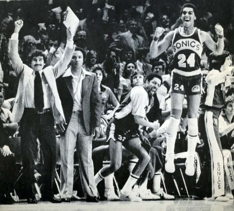 From left, SuperSonics assistant coach Les Habegger, head coach Lenny Wilkens, team captian Fred Brown and Dennis Johnson celebrate as their 1979 championship win over the Washington Bullets neared. (seattlepi.com file)