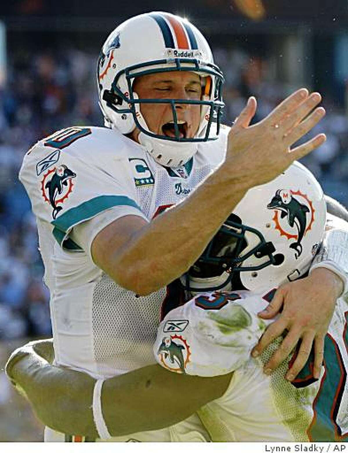 Miami Dolphins quarterback Chad Pennington, left, and running back Ronnie Brown, right, celebrate after he scored a touchdown in the fourth quarter against the Seattle Seahawks during a football game in Miami, Sunday, Nov. 9, 2008. The Dolphins won 21-19. (AP Photo/Lynne Sladky)