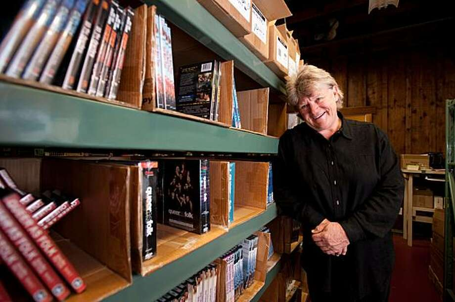 Kathy Wolfe, founder of Wolfe Video which distrubutes gay and lesbian films, poses in the DVD distribution area of her adobe-style office which was once a Wells Fargo stop in the 1800's during the New Almaden Quicksilver mining days.   **Kathy Wolfe Photo: Chad Ziemendorf, Special To The Chronicle