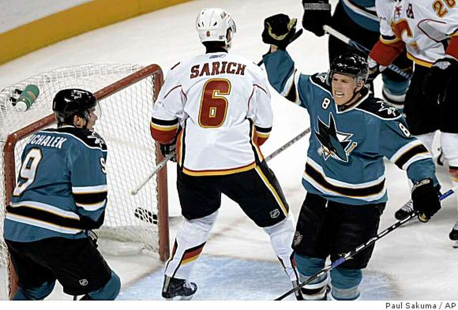 San Jose Sharks center Joe Pavelski, right, celebrates after scoring past Calgary Flames defenseman Cory Sarich (6) as left wing Milan Michalek (9), of Czech Republic, watches in the first period of an NHL hockey game in San Jose, Calif., Thursday, Nov. 13, 2008. (AP Photo/Paul Sakuma) Photo: Paul Sakuma, AP