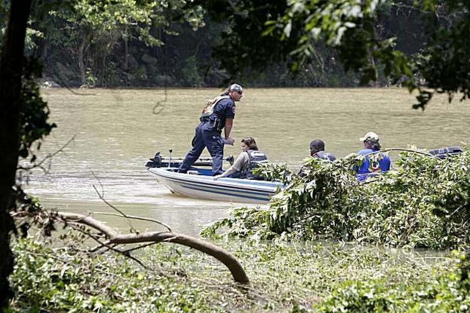 Officials search near the edge of the Little Missouri River near Langley, Ark., Saturday, June 12, 2010 after a flash flood that swept through a popular campground killing numerous people. Rescue crews took to kayaks, horseback and ATVs on Saturday to resume the desperate search for about two dozen campers still missing after flash floods swept through a popular campground. Photo: Sue Ogrocki, AP