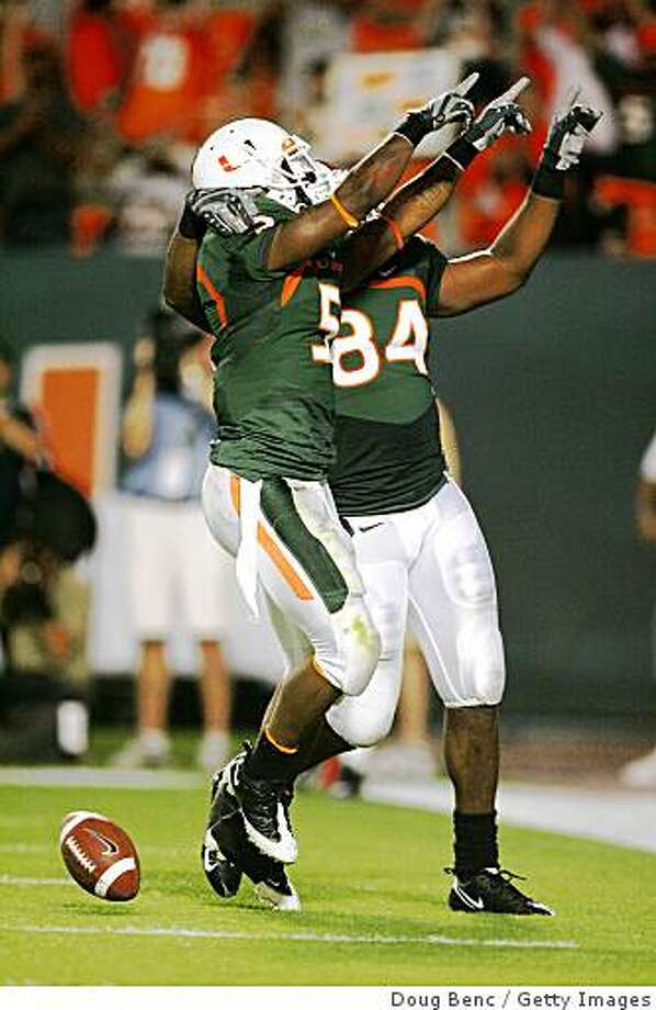 Miami Hurricanes Javarris James (5) and tight end Richard Gordon (84) celebrate after James' touchdown against the Virginia Tech Hokies at Dolphin Stadium on November 13, 2008 in Miami, Photo: Doug Benc, Getty Images