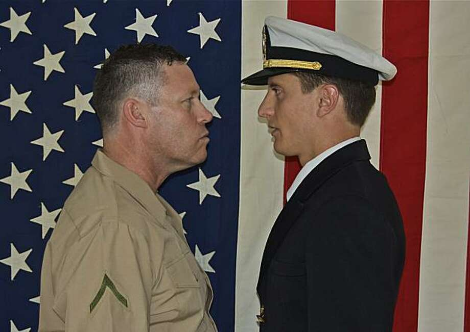 "John Flanagan (left) as Marine Col. Nathan Jessup and Elias Escobedo as Lt. Daniel Kaffee in ""A Few Good Men"" at Hapgood Theatre Photo: Josy Miller"